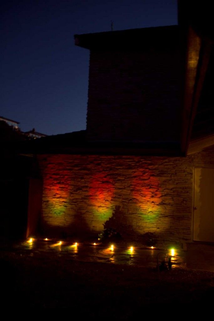 Front walkway and wall lit at dusk by Lightify GardenSpot RGB lights